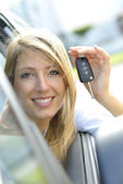 Woman showing car key — Stock Photo