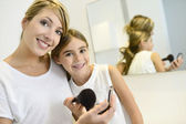 Girl playing with her mom's makeup — Stock Photo