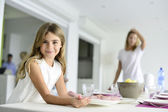Girl helping putting the table up — Stock Photo