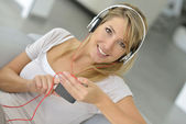 Blond woman listening to music — Stock Photo