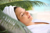 Woman relaxing outside spa resort — Stock Photo