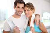 Couple in fitness gym — Stock Photo
