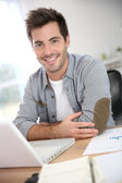 Man working with laptop — Stock Photo