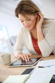 Woman working on tablet — Stock Photo