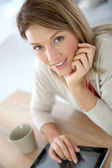 Woman connected on internet — Stock Photo