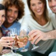 Stock Photo: Friends cheering with wine