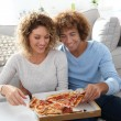 Cheerful couple having pizza — Stok fotoğraf