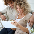 Couple at home e-shopping — Stock Photo #39705027