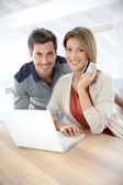 Couple doing online shopping — Stock Photo