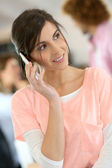 Office-worker talking on phone — Stock Photo