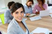 Businesswoman in work meeting — Stock Photo