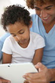 Father and child with tablet — Stock Photo