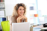 Woman sitting in front of laptop — Stock Photo