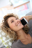 Woman talking on smartphone — Stock Photo