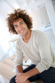 Handsome man in apartment — Stock Photo