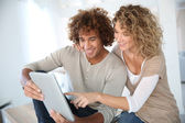 Couple websurfing on digital tablet — Stock Photo