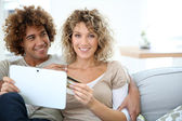 Couple at home e-shopping — Stock Photo