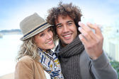 Couple taking picture — Stock Photo