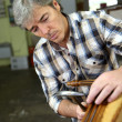 Stock Photo: Craftsmrepairing armchair