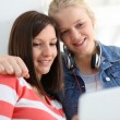Stock Photo: Girlfriends websurfing with tablet