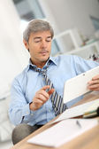 Businessman with tablet — Stock Photo