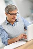 Businessman working on laptop — Stock Photo