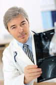Doctor checking on X-ray — Stock Photo