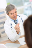 Doctor in consultation room — Stock Photo
