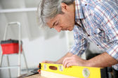 Craftsman using level — Foto de Stock