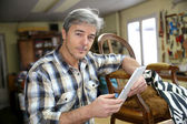 Craftsman with digital tablet — Stock Photo