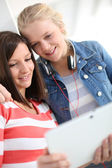 Girlfriends websurfing with tablet — Stock Photo