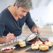 Stock Photo: Mpreparing pastries