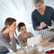 Stock Photo: Family preparing pastry