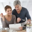 Stock Photo: Couple cooking together