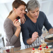 Couple preparing pastry — Stock Photo