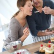 Wife tasting cake — Stock Photo