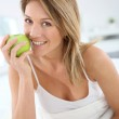 Woman giving bite to apple — Stock Photo #41334179