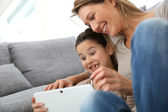 Mother and daughter with tablet — Foto Stock