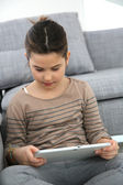 Girl playing with tablet — Stock Photo