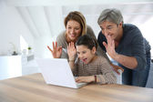 Family making call on internet — Stock Photo