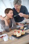 Wife tasting cake — Stock Photo