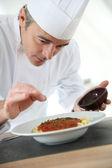 Chef presenting italian dish — Stock Photo