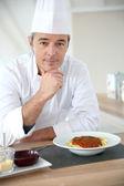 Chef in kitchen — Stock Photo