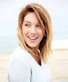Mature woman on beach — Stock Photo