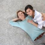 Couple laying on carpet floor — Stockfoto