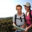 Hikers looking at map — Stock Photo #43754493