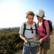 Hikers looking at map — Stock Photo #43754495