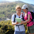 Hikers looking at map — Stock Photo #43754511