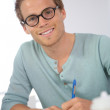 Man filling in application form — Stock Photo #43754581