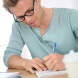 Man filling in application form — Stock Photo #43755203